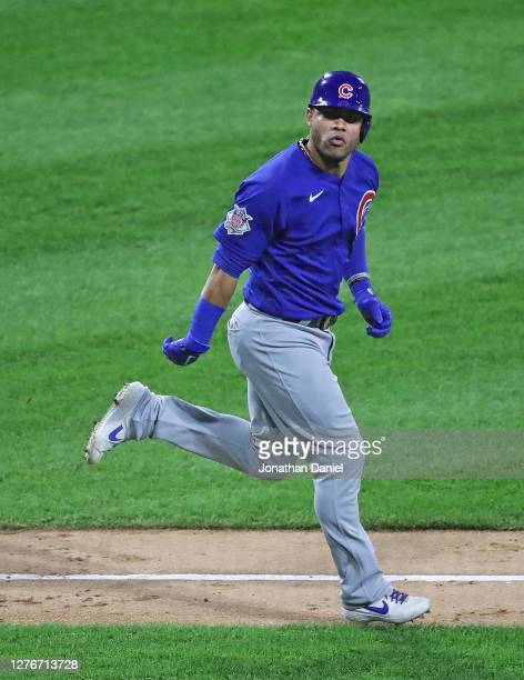 Willson Contreras of the Chicago Cubs looks at the Cubs dugout as he runs the bases after hitting a three run home run in the 3rd inning against the...
