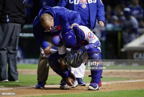 Willson Contreras of the Chicago Cubs reacts after being struck by a pitch in the eighth inning against the Los Angeles Dodgers during game three of...