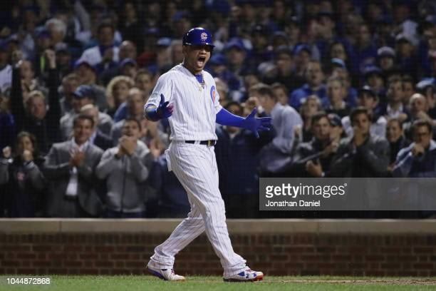 Willson Contreras of the Chicago Cubs reacts after being walked in the seventh inning against the Colorado Rockies during the National League Wild...