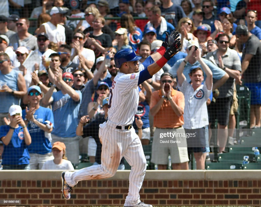 Willson Contreras #40 of the Chicago Cubs reacts after crossing home plate after hitting a home run against the Detroit Tigers during the sixth inning on July 4, 2018 at Wrigley Field in Chicago, Illinois.