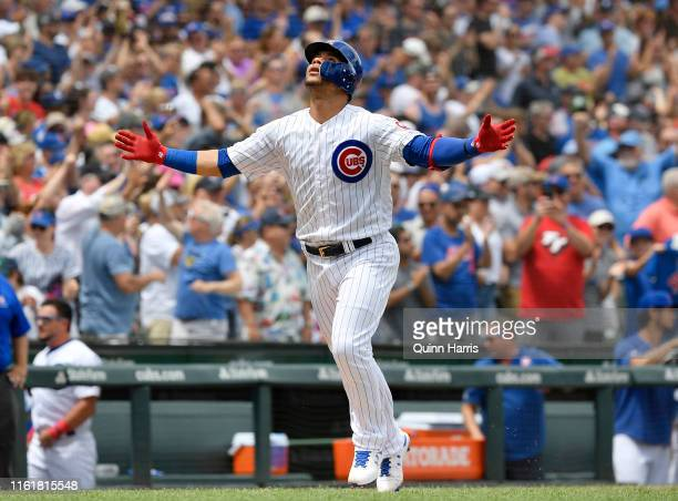 Willson Contreras of the Chicago Cubs reacts after hitting a three run home run in the first inning against the Pittsburgh Pirates at Wrigley Field...
