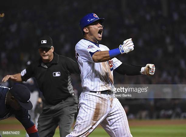 Willson Contreras of the Chicago Cubs reacts after hitting a twoRBI triple against the Atlanta Braves during the eighth inning on July 7 2016 at...