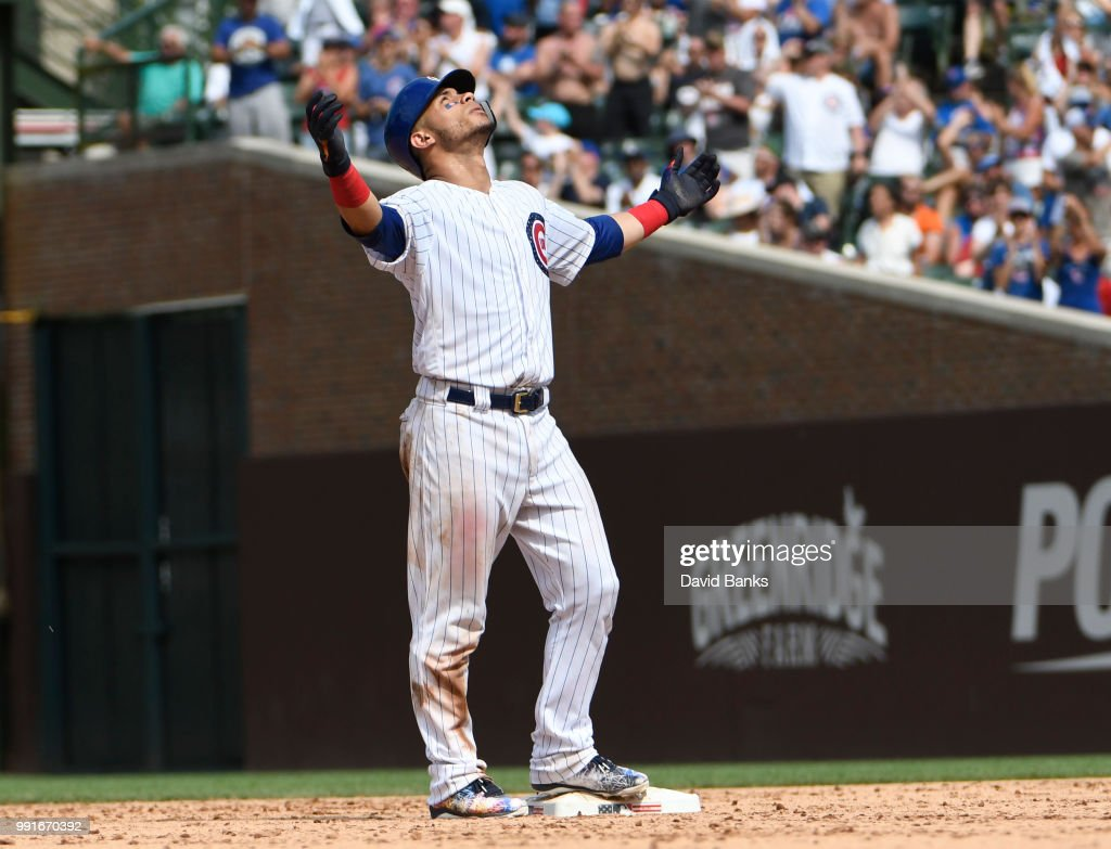Willson Contreras #40 of the Chicago Cubs reacts after hitting a two-RBI double against the Detroit Tigers during the seventh inning on July 4, 2018 at Wrigley Field in Chicago, Illinois.