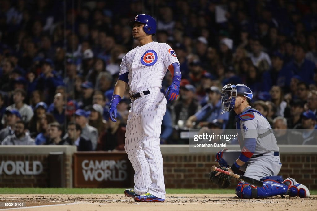 Willson Contreras #40 of the Chicago Cubs reacts to hitting a home run in the second inning against the Los Angeles Dodgers during game four of the National League Championship Series at Wrigley Field on October 18, 2017 in Chicago, Illinois.