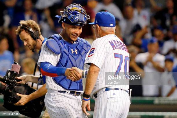 Willson Contreras of the Chicago Cubs smiles as he shakes hands with manager Joe Maddon after their win over the St Louis Cardinals at Wrigley Field...