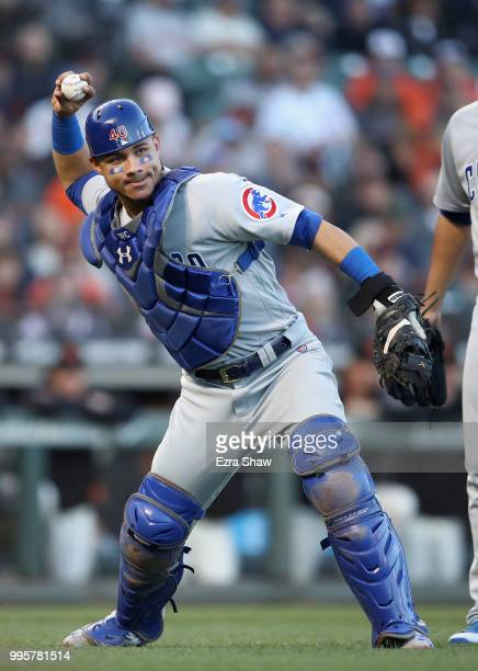 Willson Contreras of the Chicago Cubs throws out Nick Hundley of the San Francisco Giants at first base in the second inning at ATT Park on July 10...