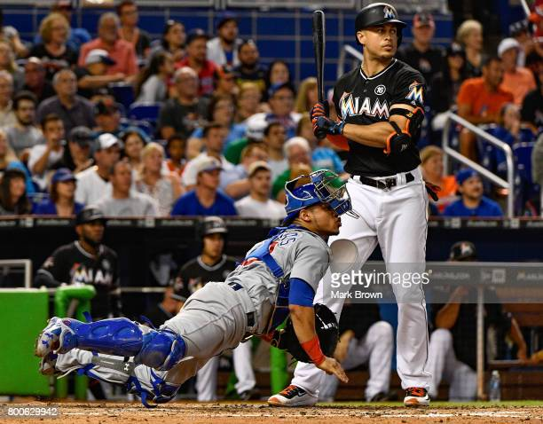 Willson Contreras of the Chicago Cubs throws to third base in the sixth inning during the game between the Miami Marlins and the Chicago Cubs at...