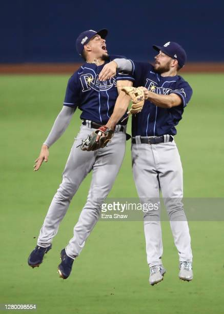Willy Adames and Brandon Lowe of the Tampa Bay Rays celebrate a 5-2 win against the Houston Astros in Game Three of the American League Championship...