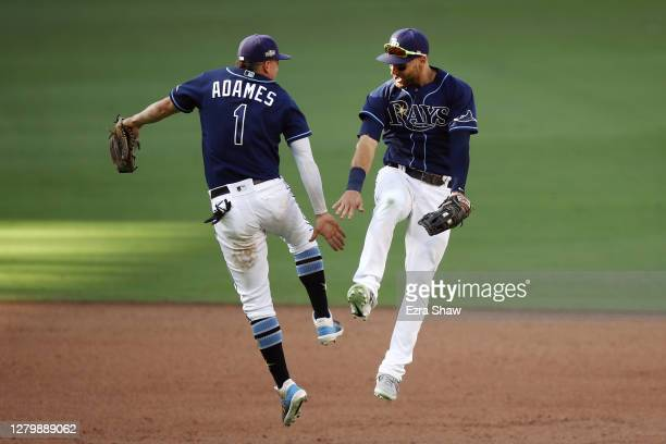 Willy Adames and Kevin Kiermaier of the Tampa Bay Rays celebrate the teams 4-2 victory against the Houston Astros in Game Two of the American League...