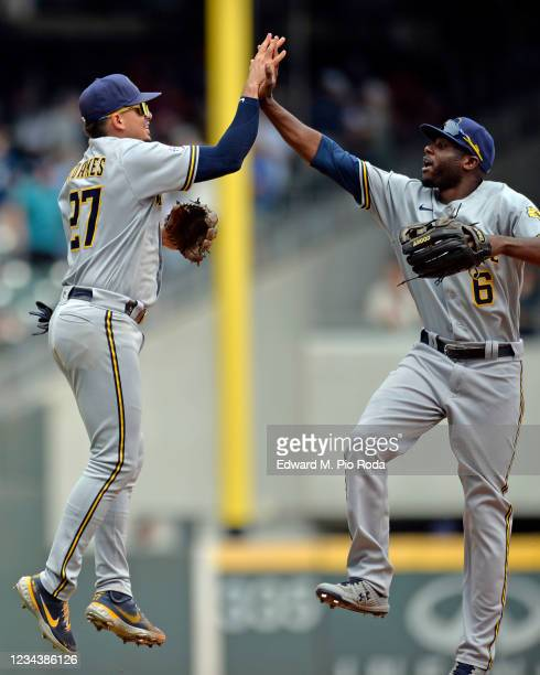 Willy Adames and Lorenzo Cain of the Milwaukee Brewers celebrate after winning against the Atlanta Braves at Truist Park on August 1, 2021 in...