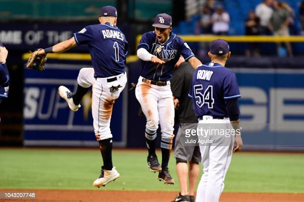 Willy Adames and Mallex Smith of the Tampa Bay Rays celebrate after a 43 win over the Toronto Blue Jays on September 29 2018 at Tropicana Field in St...