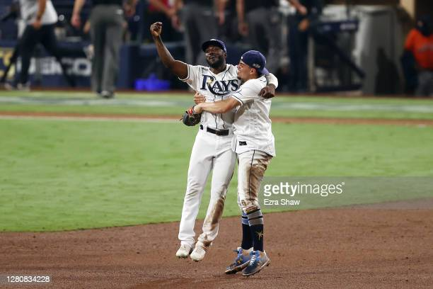 Willy Adames and Randy Arozarena of the Tampa Bay Rays celebrate a series win against the Houston Astros in Game Seven of the American League...