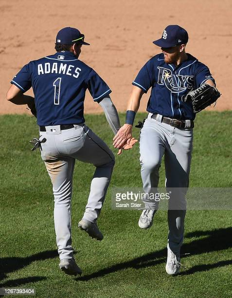 Willy Adames celebrates with Michael Brosseau of the Tampa Bay Rays during the ninth inning against the New York Yankees at Yankee Stadium on August...