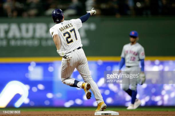 Willy Adames of the Milwaukee Brewers hits a solo home run in the third inning against the New York Mets at American Family Field on September 24,...