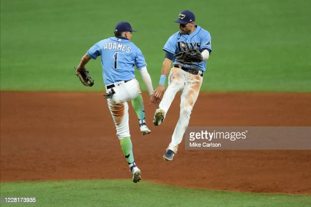Willy Adames of the Tampa Bay Rays and Kevin Kiermaier celebrate a win over the Toronto Blue Jays in a baseball game at Tropicana Field on August 23,...