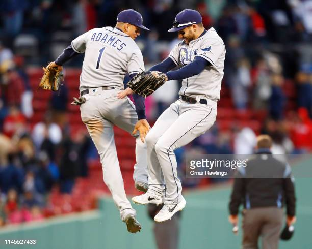Willy Adames of the Tampa Bay Rays and Kevin Kiermaier of the Tampa Bay Rays jump lowfive after the victory over the Boston Red Sox at Fenway Park on...