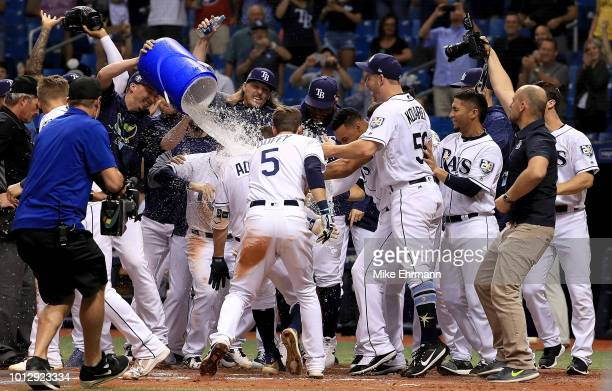 Willy Adames of the Tampa Bay Rays celebrates a walk off home run in the ninth inning during a game against the Baltimore Orioles at Tropicana Field...