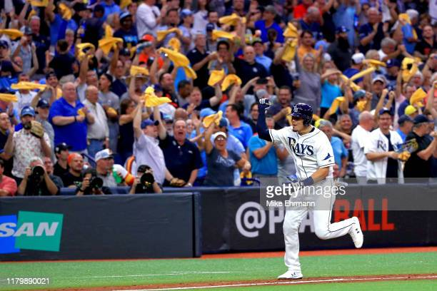 Willy Adames of the Tampa Bay Rays celebrates after he hits a home run against the Houston Astros during the fourth inning in game four of the...