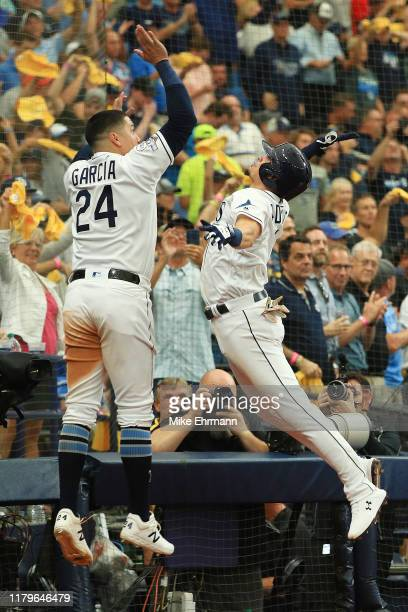 Willy Adames of the Tampa Bay Rays celebrates with Avisail Garcia after hitting a solo home run against the Houston Astros during the sixth inning in...
