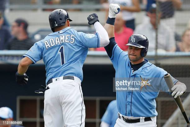 Willy Adames of the Tampa Bay Rays celebrates with Mike Zunino after hitting a solo home run in the fifth inning against the New York Yankees during...