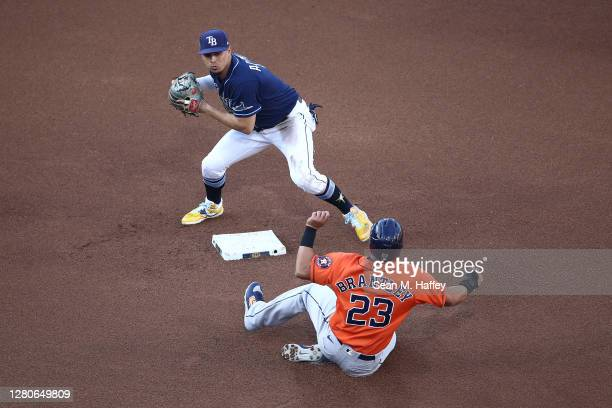 Willy Adames of the Tampa Bay Rays forces out Michael Brantley of the Houston Astros at second during the fourth inning in Game Six of the American...