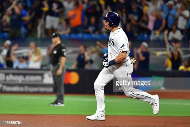 Willy Adames of the Tampa Bay Rays hits a home run against the Houston Astros during the fourth inning in game four of the American League Division...