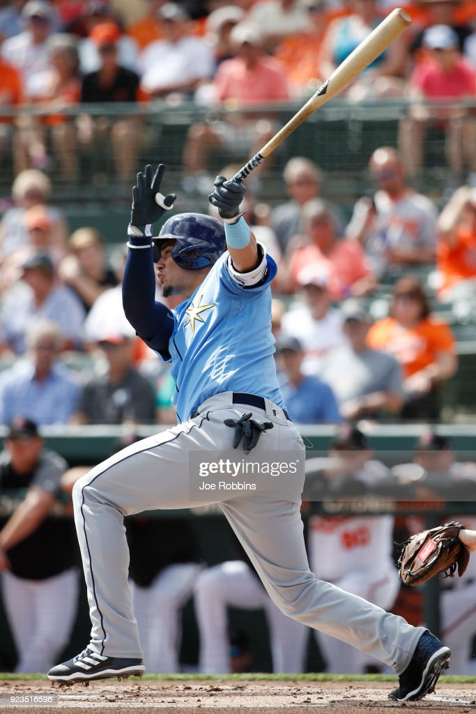 Willy Adames #1 of the Tampa Bay Rays hits a sacrifice fly to drive in a run against the Baltimore Orioles during a Grapefruit League spring training game at Ed Smith Stadium on February 23, 2018 in Sarasota, Florida. The Rays won 6-3.