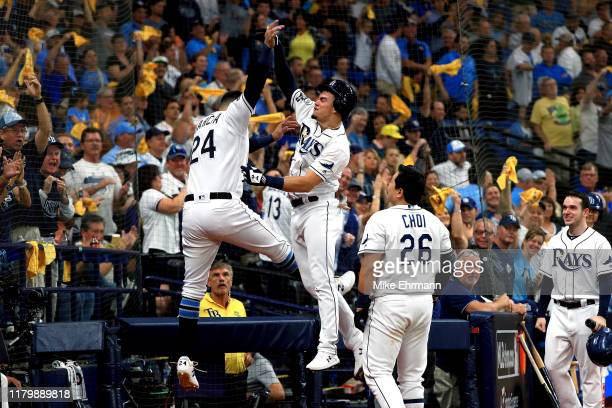 Willy Adames of the Tampa Bay Rays is congratulated by his teammates after hitting a solo home run against the Houston Astros during the fourth...