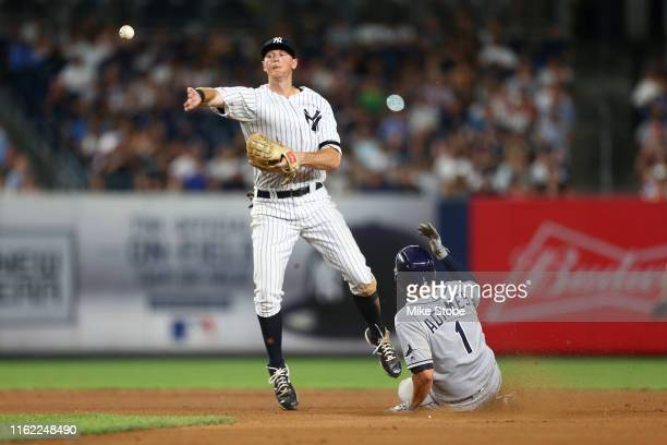 Willy Adames of the Tampa Bay Rays is forced out as DJ LeMahieu of the New York Yankees completes the double play in the seventh inning at Yankee...