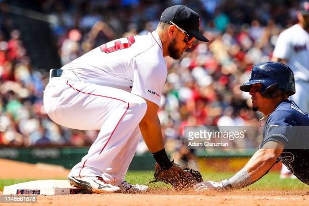 Willy Adames of the Tampa Bay Rays is tagged out at first base by Michael Chavis of the Boston Red Sox in the fourth inning during game one of a...