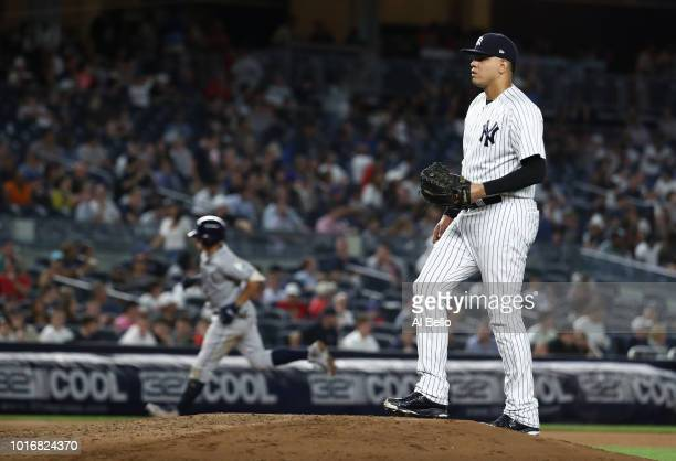 Willy Adames of the Tampa Bay Rays rounds the bases after hitting a home run in the eigth inning against Dellin Betances of the New York Yankees...