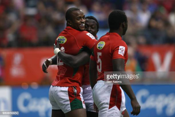 Willy Ambaka hugs Oscar Ouma and Billy Odhiambo of Kenya after scoring a try against Fiji during the gold medal game at Canada Sevens the Sixth round...