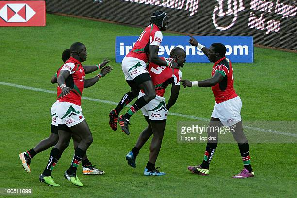 Willy Ambaka of Kenya is congratulated on his winning try by teammates after winning the semifinal cup match between New Zealand and Kenya during the...