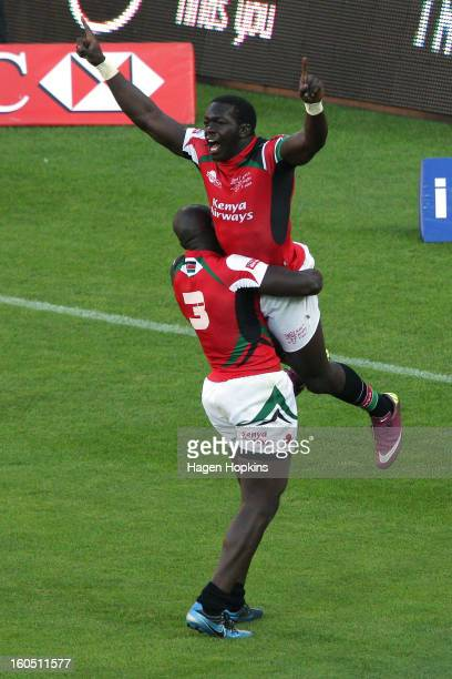 Willy Ambaka of Kenya is congratulated on his winning try by teammate Horace Otieno in the semifinal cup match between New Zealand and Kenya during...