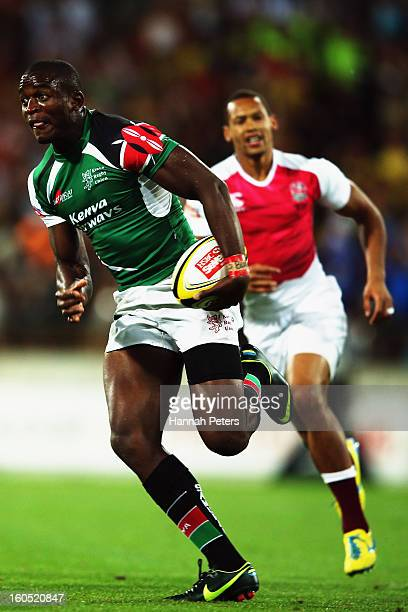 Willy Ambaka of Kenya makes a break during the grand final between England and Kenya during the 2013 Wellington Sevens at Westpac Stadium on February...