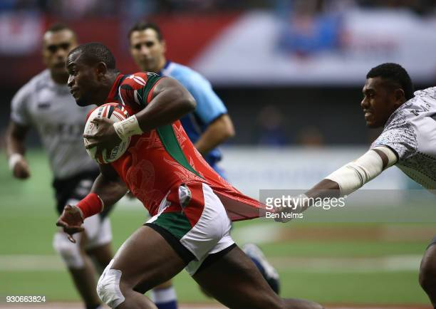 Willy Ambaka of Kenya runs with the ball against Kalione Nasoko of Fiji during the gold medal game at Canada Sevens the Sixth round of the HSBC...