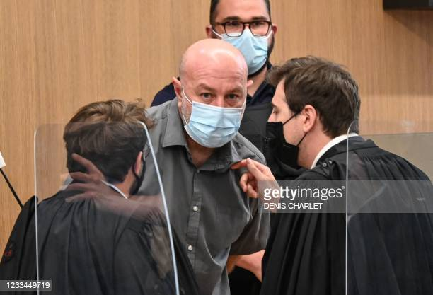 Willy Bardon talks to his lawyers from the defendant box before the opening of his appeal trial, after he was sentenced in December 2019 to thirty...
