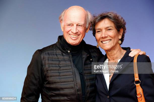 Image has been digitally retouched Willy Bogner and wife Sonia Bogner arrive at the 'Eddie the Eagle' premiere on March 20 2016 in Munich Germany