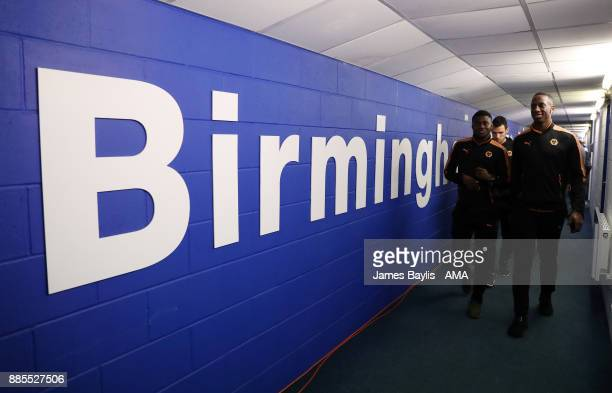 Willy Boly and Bright Enobakhare of Wolverhampton Wanderers arrive at the stadium before the Sky Bet Championship match between Birmingham City and...