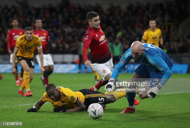 Willy Boly and John Ruddy of Wolverhampton Wanderers challenge Andreas Pereira of Manchester United during the FA Cup Quarter Final match between...