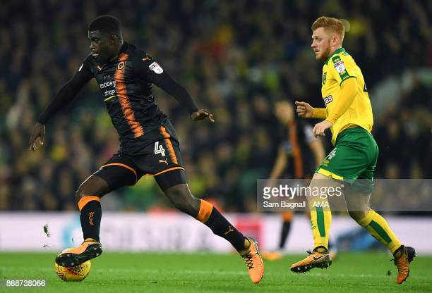 Willy Boly of Wolverhampton Wanderers and Harrison Reed of Norwich City compete during the Sky Bet Championship match between Norwich City and...