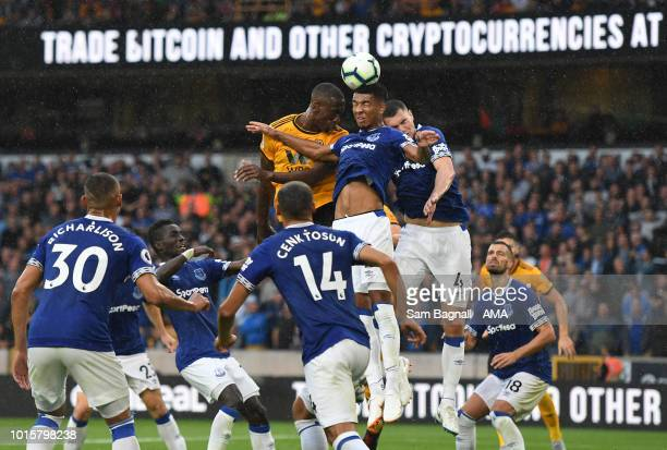 Willy Boly of Wolverhampton Wanderers and Mason Holgate of Eveton during the Premier League match between Wolverhampton Wanderers and Everton FC at...
