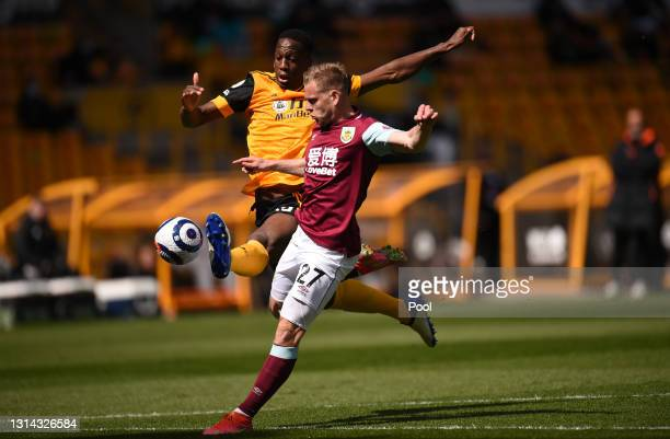 Willy Boly of Wolverhampton Wanderers battles for possession with Matej Vydra of Burnley during the Premier League match between Wolverhampton...