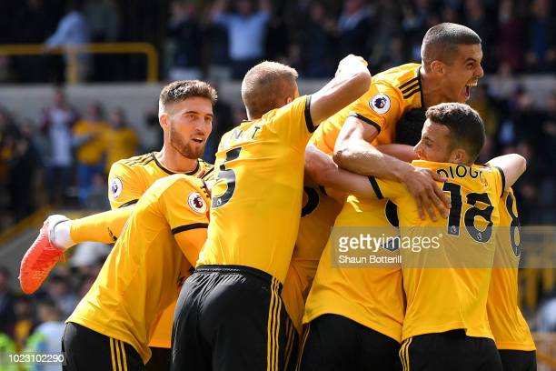 Willy Boly of Wolverhampton Wanderers celebrates after scoring his team's first goal with team mates during the Premier League match between...
