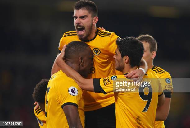 Willy Boly of Wolverhampton Wanderers celebrates with Ruben Neves and team mates as he scores his team's first goal during the Premier League match...