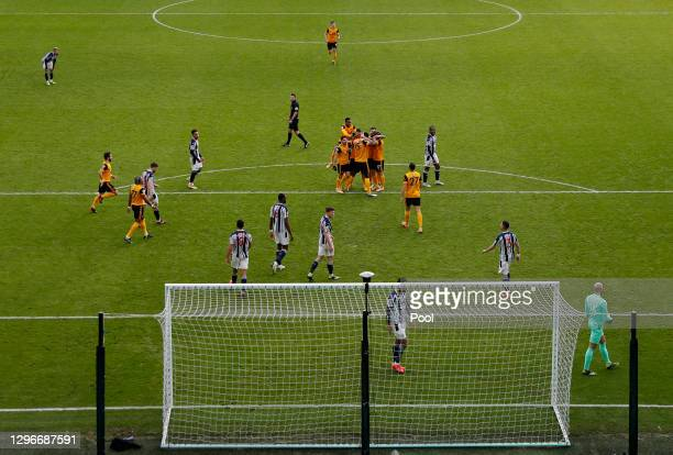 Willy Boly of Wolverhampton Wanderers celebrates with teammates after scoring his team's second goal during the Premier League match between...