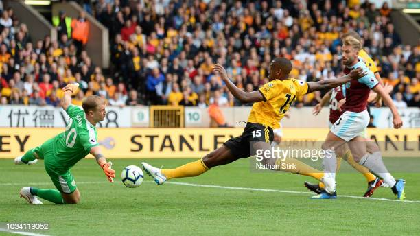 Willy Boly of Wolverhampton Wanderers has a shot saved by Joe Hart of Burnley during the Premier League match between Wolverhampton Wanderers and...