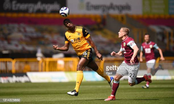 Willy Boly of Wolverhampton Wanderers heads the ball under pressure from Matej Vydra of Burnley during the Premier League match between Wolverhampton...