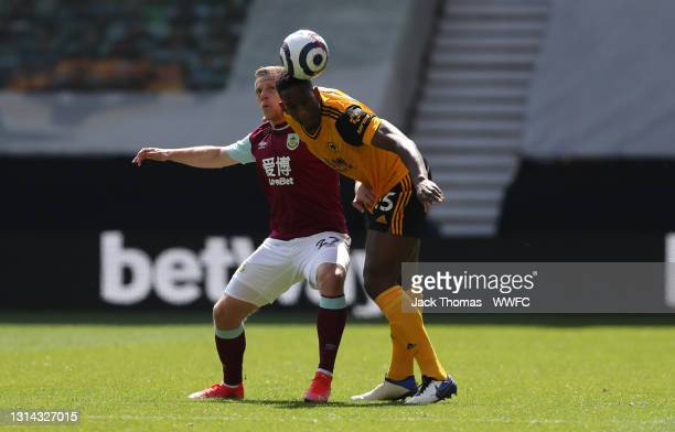 Willy Boly of Wolverhampton Wanderers heads the ball whilst under pressure from Matej Vydra of Burnley during the Premier League match between...