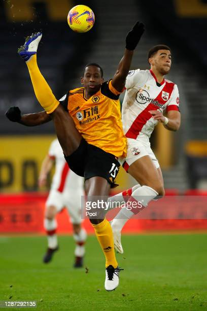 Willy Boly of Wolverhampton Wanderers is challenged by Che Adams of Southampton during the Premier League match between Wolverhampton Wanderers and...